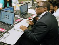 a man in class with computers